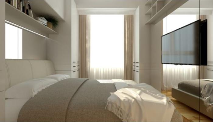 Habitación con cama de matrimonio e iluminación natural